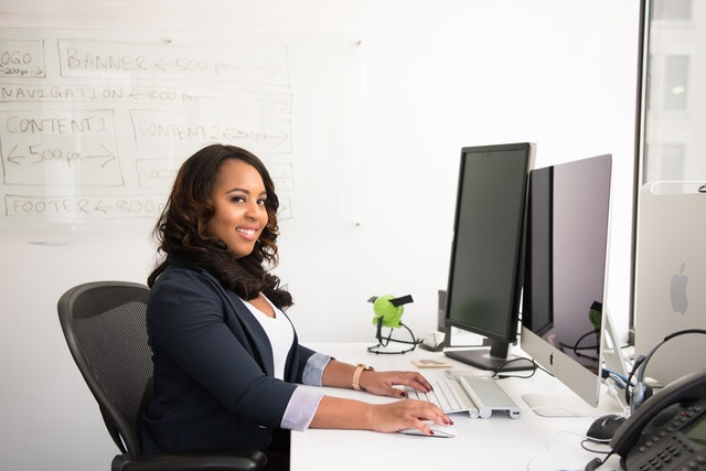 female office worker with small business phone service